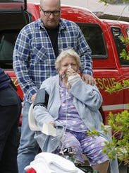 A woman is given oxygen after being evacuated from