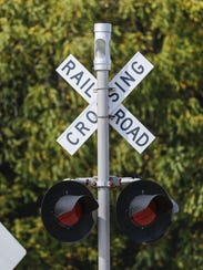 A railroad crossing signal at the Meadow Lane railroad
