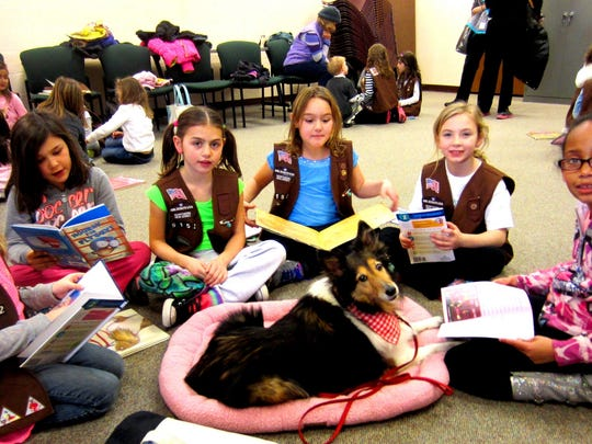 A 2010 photo of Wayne Girl Scout Brownies who met Polly as a part of a seminar about therapy dogs.