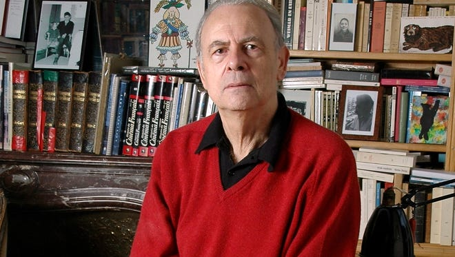 In this undated photo provided by publisher Gallimard, French novelist Patrick Modiano poses for a photograph. Patrick Modiano of France has won the 2014 Nobel Prize for Literature.