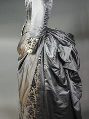 This three-piece afternoon dress from the 1880s is