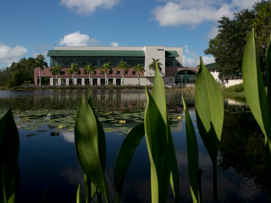 The Florida Gulf Coast University library is framed by aquatic plants. The university was built on wetlands and touts itself as an environmental steward.