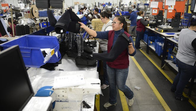Edith Anguiano Reyes works on a production line making orthopedic braces at DJO Global, a medical device manufacturing company in Tijuana, in 2012.