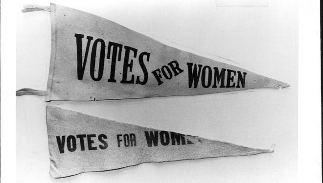 A triangular, felt pennant used by Rochester Suffragists.