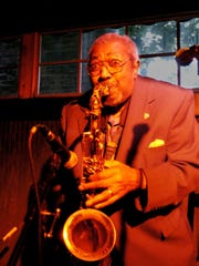The late Big Joe Burrell performs on his saxophone at Halvorson's Upstreet Cafe in Burlington on June 2, 2004 — at the kickoff of the 21st Discover Jazz Festival.