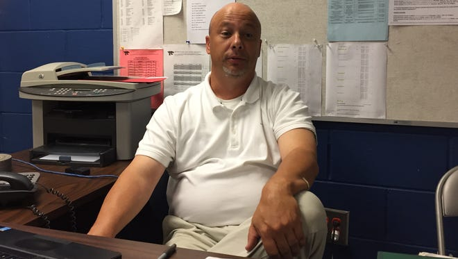 Jet Turner talks about his career and his first six months as football coach at Woodmont in his office Tuesday.