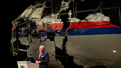 With the reconstructed cockpit displayed behind, Tjibbe Joustra, head of the Dutch Safety Board presents the board's final report into what caused Malaysia Airlines Flight 17 to break up high over Eastern Ukraine last year, killing all 298 people on board, during a press conference in Gilze-Rijen, central Netherlands, Tuesday, Oct. 13, 2015. (AP Photo/Peter Dejong)