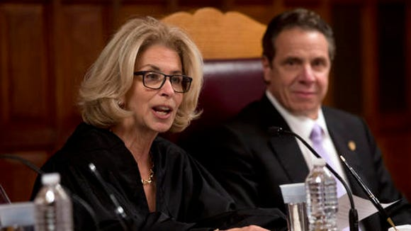Chief Judge Janet DiFiore speaks at the Court of Appeals after being sworn in by Gov. Andrew Cuomo, right, on Monday, Feb. 8, 2016 (AP Photo/Mike Groll)