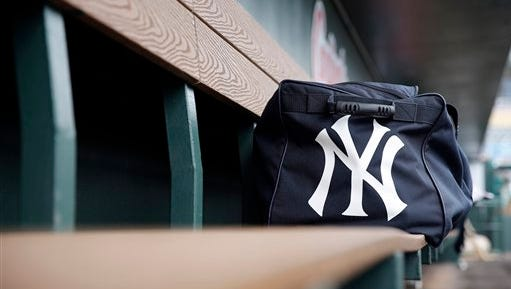 A New York Yankees bag sits in their dugout before the start of an exhibition spring training baseball game between the Miami Marlins and the New York Yankees Tuesday, March 8, 2016, in Jupiter, Fla. (AP Photo/Jeff Roberson)