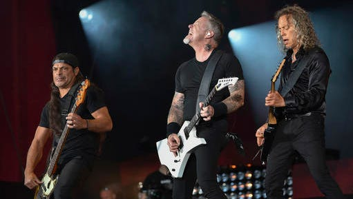 """FILE - In this Sept. 24, 2016, file photo, musicians Robert Trujillo, left, James Hetfield and Kirk Hammett of Metallica perform at the 2016 Global Citizen Festival in Central Park in New York. Metallica joined Jimmy Fallon and The Roots for a toy instrument rendition of its hit, """"Enter Sandman,"""" in a segment that aired on """"The Tonight Show"""" on Nov. 16, 2016."""