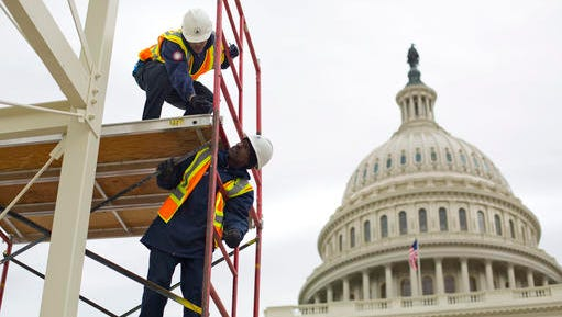 FILE - In this Dec. 8, 2016, file photo, construction continues for the Inauguration and swearing-in ceremonies for President-elect Donald Trump on the Capitol steps in Washington. It's typically an unquestioned honor to participate in the inauguration of an American president. This time, though, it's different. The sharp divisions over Donald Trump's election have politicians, celebrities and even high school students debating whether taking part in the inauguration is a political act that demonstrates support for the new president and his agenda or a nonpartisan tribute to democratic traditions and the peaceful transfer of power.