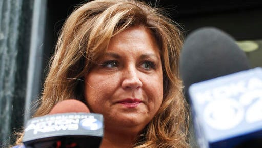 """FILE- In this June 27, 2016, file photo, """"Dance Moms"""" star Abby Lee Miller leaves federal court after pleading guilty in Pittsburgh to bankruptcy fraud and failing to report thousands of dollars in Australian currency she brought into the country. Miller is scheduled to appear in federal court in Pittsburgh on Friday, Jan. 20, 2017, for the start of her sentencing hearing in her bankruptcy fraud case."""