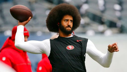 "FILE - In this Dec. 4, 2016, file photo, San Francisco 49ers quarterback Colin Kaepernick warms up before an NFL football game against the Chicago Bears. Spike Lee said on Instagram Sunday, March 19, 2017, that it was ""fishy"" that Kaepernick, now a free agent, hadn't been signed."""