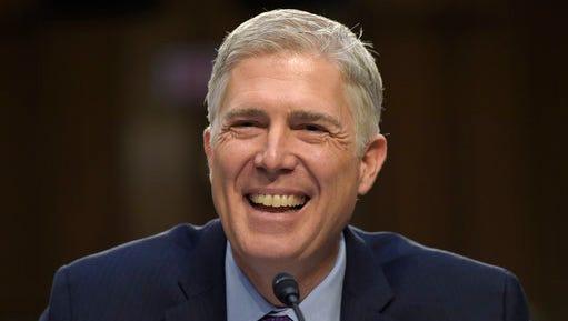 Supreme Court Justice nominee Neil Gorsuch smiles as he testifies on Capitol Hill in Washington, Tuesday, March 21, 2017, during his confirmation hearing before the Senate Judiciary Committee.