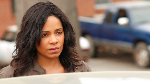 """In this image released by Fox, Sanaa Lathan appears in a scene from """"Shots Fired,"""" a drama that debuts Wednesday at 8 p.m. Eastern on Fox."""