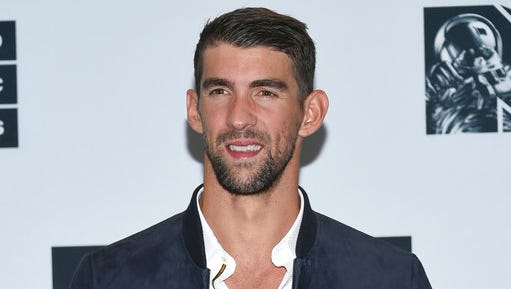 FILe - In this Aug. 28, 2016 file photo, Michael Phelps poses in the press room at the MTV Video Music Awards in New York. Phelps is participating in Discovery network's Shark Week this summer. The week of shark-themed programming in mid-summer is annually Discovery's biggest event.