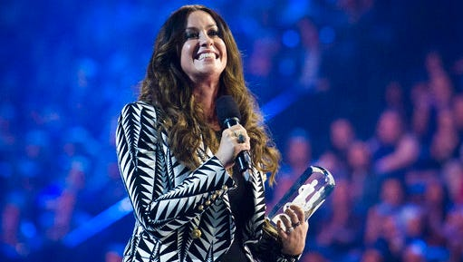 "In this March 15, 2015, file photo, singer Alanis Morissette receives her achievement from the Canadian Music Hall of Fame during the 2015 Juno Awards in Hamilton, Ont. Celebrities including Nicky Minaj and  Morissette are among the victims of what police suspect is ""flocking,"" so named because gang members flock like birds to areas where home burglaries provide the biggest payoff. Morissette had about $2 million in jewelry and valuables stolen from her Brentwood mansion."