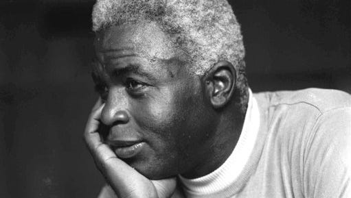 FILE - In this June 30, 1971, file photo, Jackie Robinson poses at his home in Stamford, Conn. The first statue in Dodger Stadium history belongs to Jackie Robinson. The team will unveil his likeness during Jackie Robinson Day festivities on Saturday, April 15, 2017, with his wife and extended family in attendance on the 70th anniversary of him breaking baseball's color barrier.