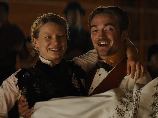 "Robert Pattinson and Mia Wasikowska star in ""Damsel."""