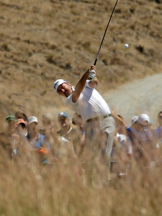 Graeme McDowell, of Northern Ireland, watches his tee shot on the 10th hole during a practice round for the U.S. Open golf tournament at Chambers Bay on Wednesday, June 17, 2015 in University Place, Wash. (AP Photo/Charlie Riedel)