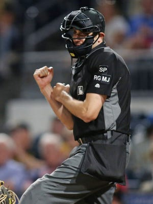Home plate umpire John Tumpane (74) reacts to a Pittsburgh Pirates strikeout against the Tampa Bay Rays during the ninth inning at PNC Park.