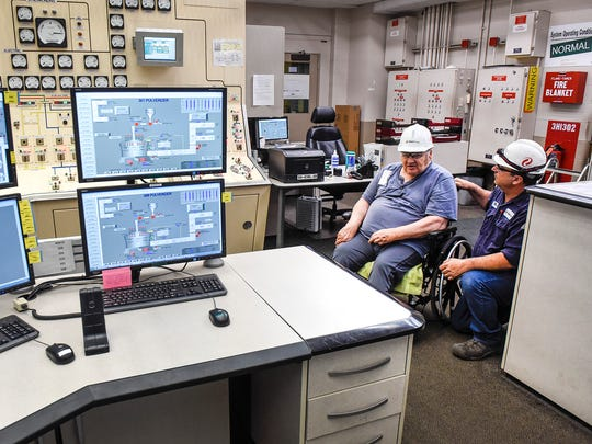 In this June 2017 file photo, veteran Robert Underhill talks about the control room with Mark Fuchs, instrument and control tech, at the Xcel Energy Sherco plant in Becker. A group of 12 veterans from St. Cloud VA Health Care System toured the coal-fired generating facility.