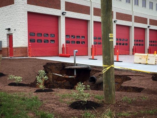 The sinkhole that opened up next to the new Palmyra fire station on Memorial Day. Citizens Fire Co. was not fully moved into the new station on the corner of Railroad and Walnut streets, and will continue to operate out of the old station at North College Street until repairs are made. The sinkhole was caused by a broken water line that saw 200,000 gallons of water drain into the ground, according to Roger Powl, the borough manager.