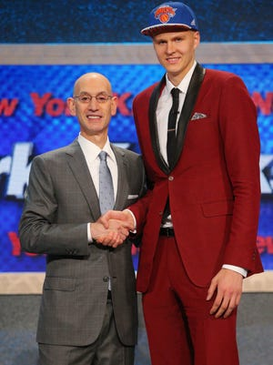 Kristaps Porzingis shakes hands with NBA commissioner Adam Silver after being selected as the number four overall pick to the New York Knicks in the first round of the 2015 NBA draft.