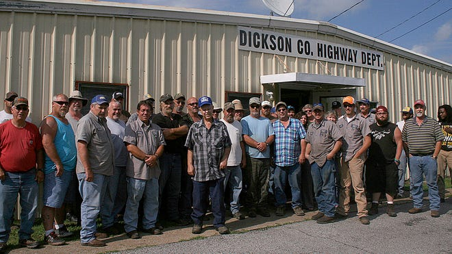 The Dickson County Highway Department employees hope to donate their sick time to co-worker Garland England, front with blue cap, who has cancer.
