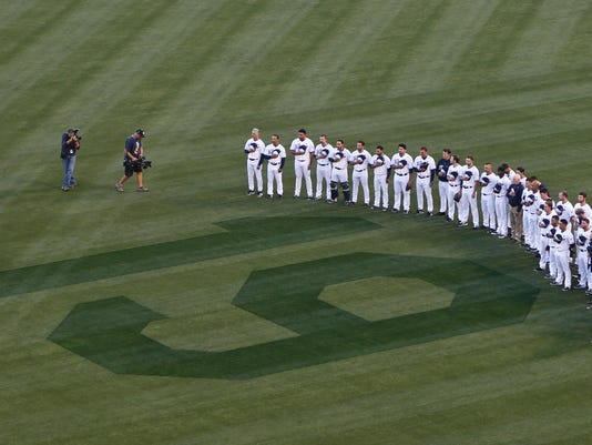 San Diego Padres players stand in right field observing 19 seconds of silence in honor of Hall of Fame player Tony Gwynn during ceremonies prior to a baseball game against the Seattle Mariners Wednesday, June 18, 2014, in San Diego. Gwynn died Monday of cancer at the age of 54.  (AP Photo/Lenny Ignelzi)