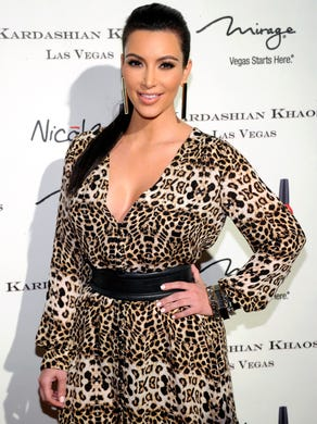 This December 2011 photo indicates just how Kardashian's style has evolved since she began dating West. No more leopard minis for her. Now, it's Celine and Tom Ford all the way.