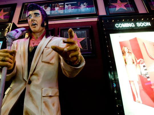 A statue of Elvis is one of the decorative memorabilia from Pollack Tempe Cinemas.