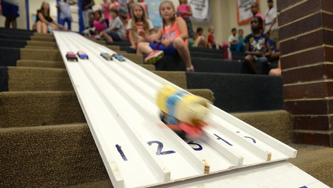 Third grade students race pine cars that they made for a class project at Bacon School, Friday, Jun. 12, 2015 in Millville.
