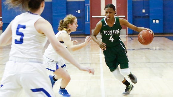 Woodlands' Teisha Hyman (4) handles the ball near mid-court durinf the girls class B quarterfinal basketball game against Bronxville at Bronxville High School on Wednesday, February 22, 2017.