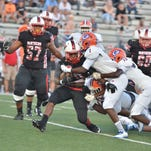Petal's Stephon Huderson carries multiple Gulfport defenders on a first down run Friday at Petal.