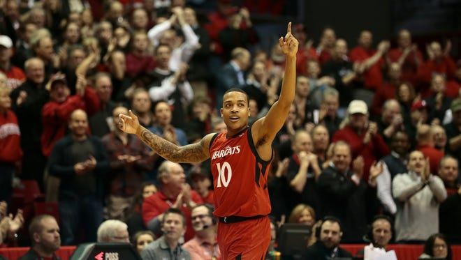 Cincinnati Bearcats senior guard Troy Caupain (10) celebrates as he comes off the court for the final time in the second half.