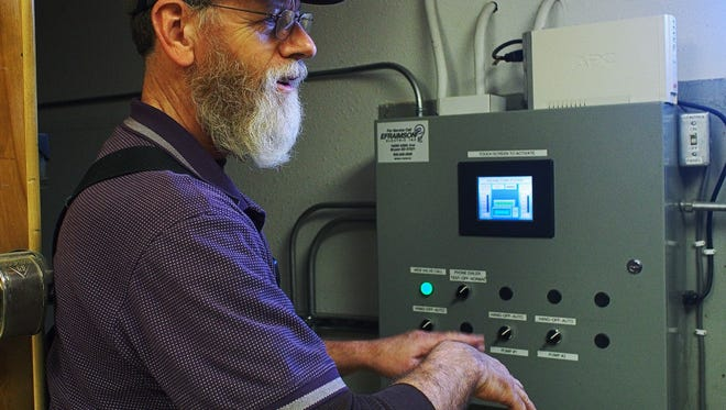 Dan Buchholz, a maintenance person for Doland shows the city's water monitoring system in 2016. The city's water showed excessive lead in 2014. Department of Environment and Natural Resources Secretary Steve Pirner said his agency might have to cease EPA-required testing unless more federal funding comes available.