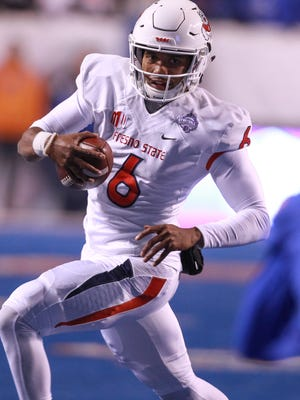Fresno State quarterback Marcus McMaryion is run out of bounds during a game against Boise State.