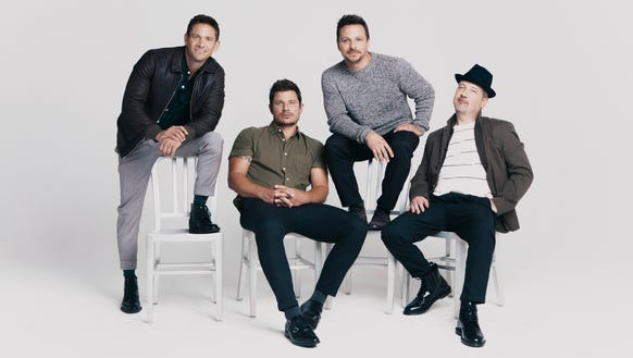 The boy band 98 Degrees is performing at the Grand