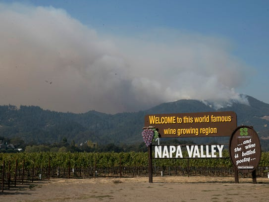 Smoke billows from a fire burning in the mountains over the Napa Valley roughly a month ago.