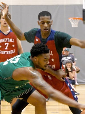 Marcus Bingham, guarding Nick Ward this summer, is one of Michigan State's key recruits.