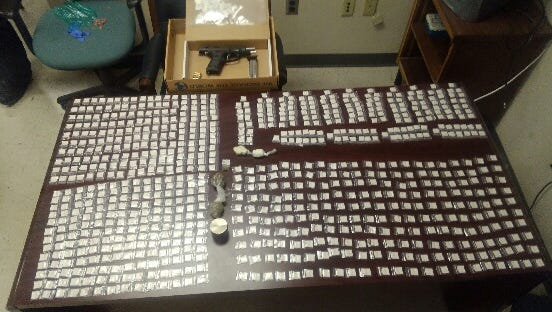 Itemsseized in a 2017 drug bust in Wilmington: a Ruger P-89, 9mm handgun containing 7 rounds; 852 bags of heroin; 27.6 grams of crack cocaine; and 15 grams of marijuana.