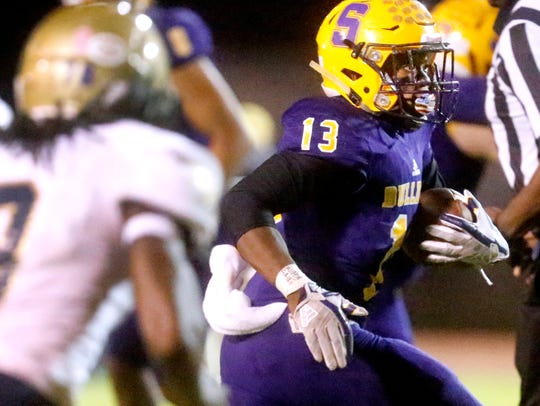Smyrna's Trae Brimm gains yardage during the Class 6A playoffs against Independence Friday. The Eagles won 14-13.