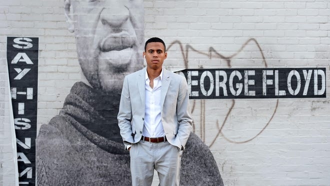 Andrey Rosado, 23, organizer of Erie Equal, is shown July 29 near a mural of George Floyd at West 29th and Peach streets in Erie, Pennsylvania. Rosado formed the group to promote peaceful protest after seeing the violence that erupted in downtown Erie late on May 30, several hours after a peaceful protest in memory of George Floyd, who died in the custody of a white police officer in Minneapolis on May 25.