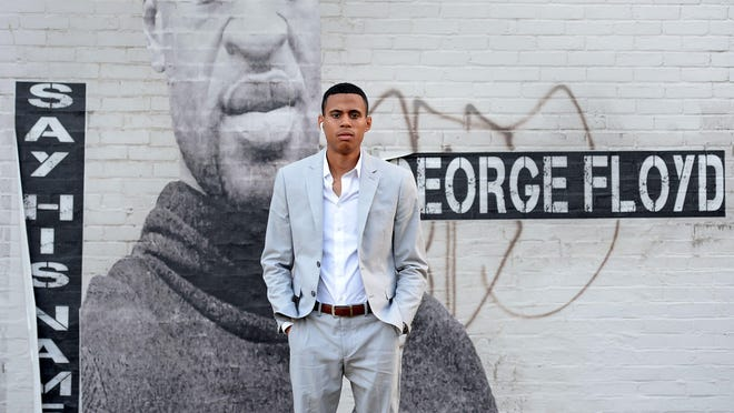 Andrey Rosado, 23, organizer of Erie Equal, is shown July 29 near a mural of George Floyd at West 29th and Peach streets in Erie. Rosado co-founded Erie Equal to promote peaceful protest after seeing the violence that erupted in downtown Erie late on May 30.