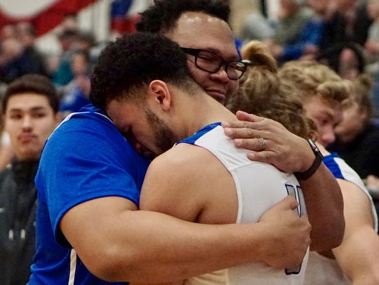 Olympic senior Jaiden Mosley gets a hug from his father
