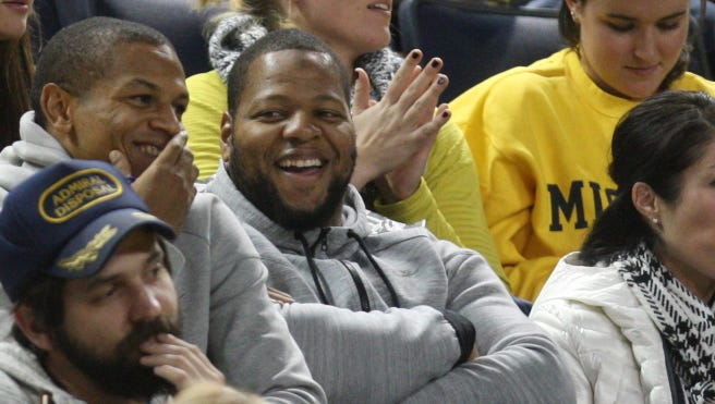 Ndamukong Suh watches Michigan play Bucknell on November 17, 2014 at Crisler Center in Ann Arbor.