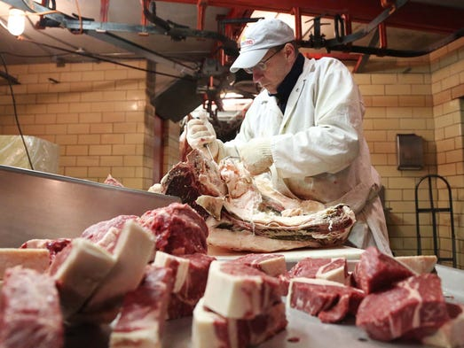 Kent Wiese, processes beef and cut steaks at Amend