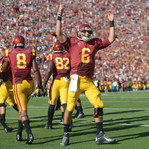 Then-Washington coach Steve Sarkisian (left) felt Cody Kessler (right) was the best QB of a talented bunch of recruits in 2013.