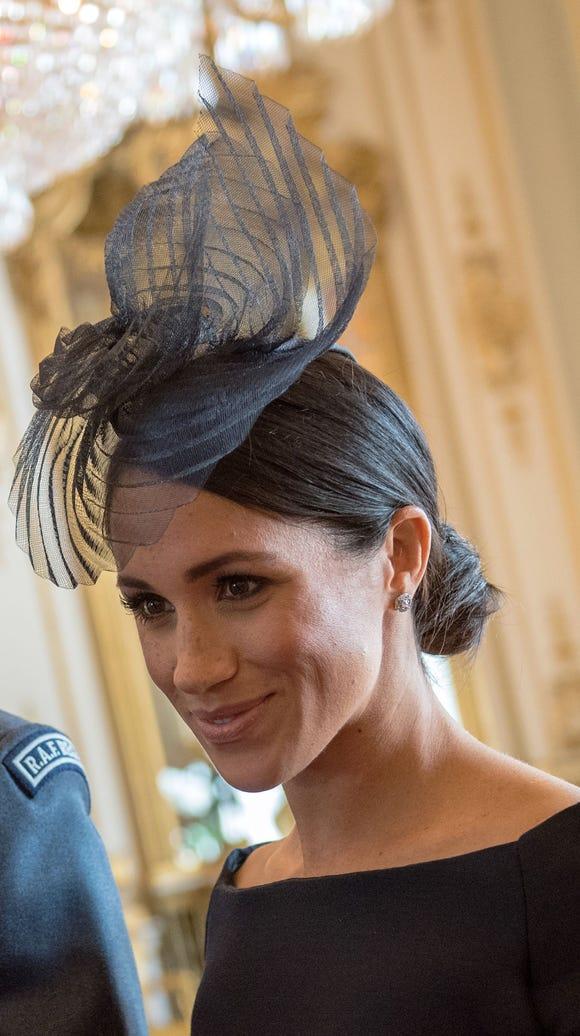 Close-up of Duchess Meghan's  Stephen Jones fascinator.